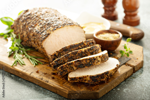 Valokuva Roasted pork loin with a spicy rub and mustard sauce