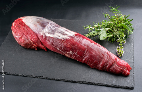 Dry aged beef fillet steak natural as closeup on black background with copy spac Fototapeta