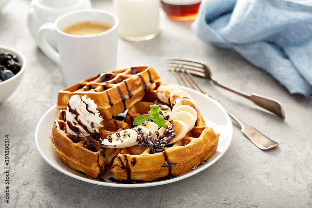 Fototapety, obrazy: Breakfast waffles with bananas and chocolate sauce