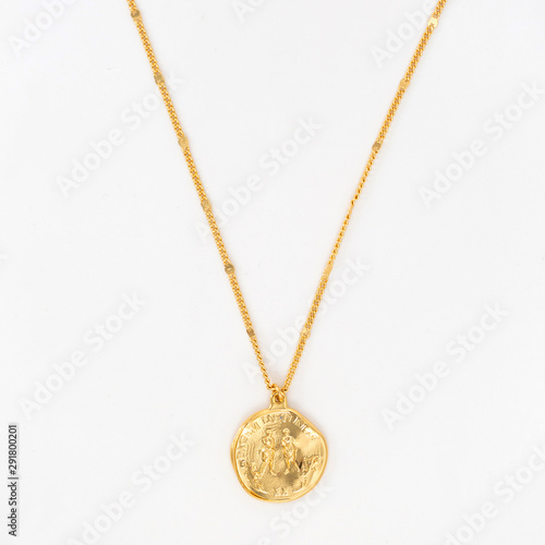 Vintage gold pendant necklace on gold chain, isolated Canvas Print