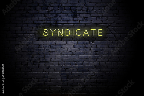 Highlighted brick wall with neon inscription syndicate Wallpaper Mural