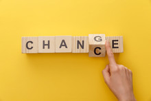 Cropped View Of Woman Switching Wooden Cube From Word Change To Chance On Yellow Background