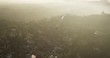 Sun pouring over LA city landscape, helicopter aerial