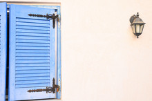 Old Wooden Window Closed Shutters. Mediterranean House