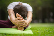 Senior Asian woman practicing yoga exercise outdoor in the morning. senior healthy lifestyle concept.