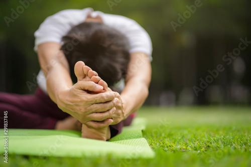 Fotografia, Obraz  Senior Asian woman practicing yoga exercise outdoor in the morning