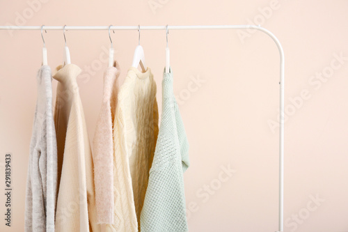 Rack with stylish clothes on light background Fototapeta