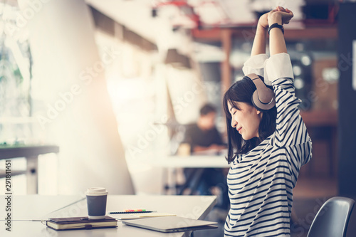 Carta da parati  Asain young girl stretching her arms to relax after finish working