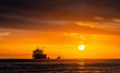 canvas print picture - Oil tankers ship at sea on a background of sunset sky. Oil tankers in the ocean. Early in the morning, the sunrise sky. South Africa. Mossel Bay
