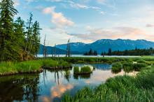 Sunset Marsh Inlet On Coast With Mountain Landscape Reflection