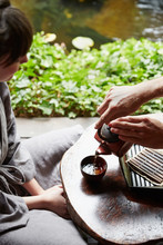 Man Pouring Tea For Woman At J...