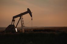 Oil Derrick At Dusk In North Dakota Bakken.