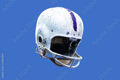 A worn and aged vintage old style American football helmet Wallpaper Mural