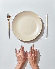 Waiting For Dinner At The Table, Served Empty Dish And Cutlery Female's Handon A White Background, Place For Text. Top View.