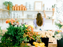 Florist Working In Her Studio