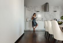 Woman In Contemporary Kitchen ...