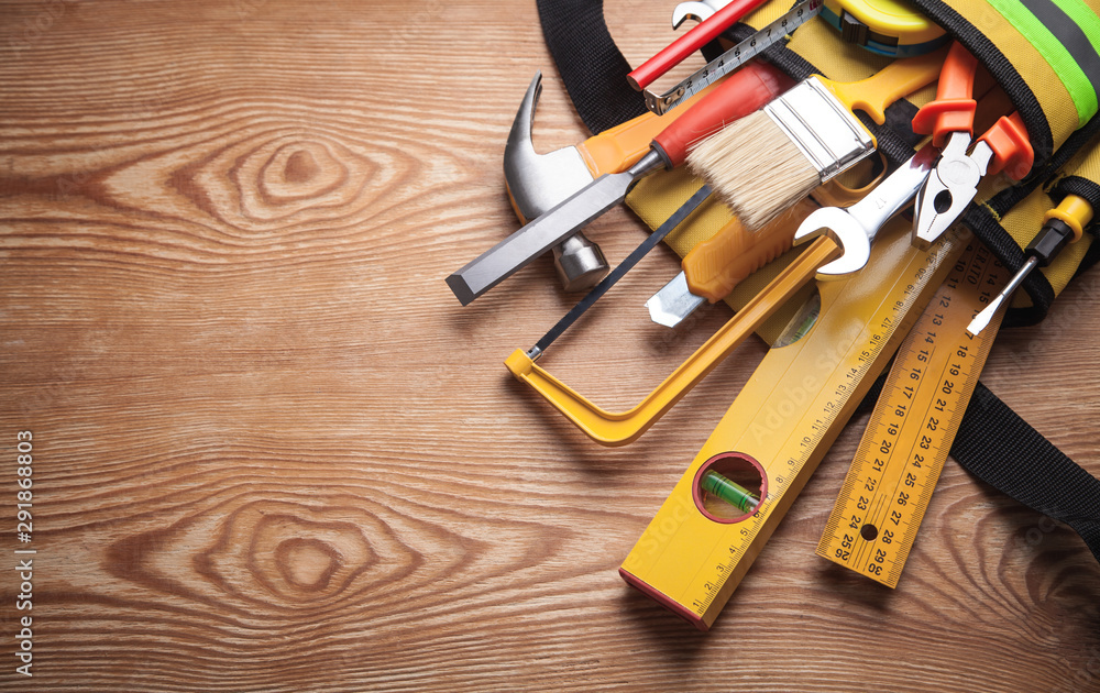 Fototapety, obrazy: Work tools on wooden background.