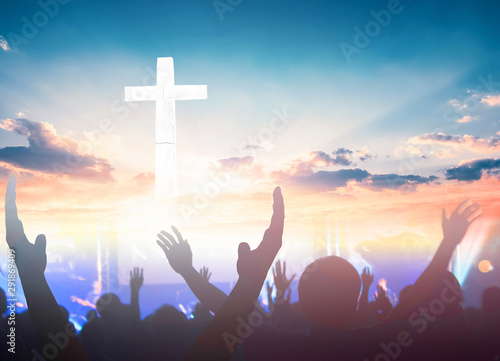 Worship and praise concept: christian people hand rising on sunset background Poster Mural XXL