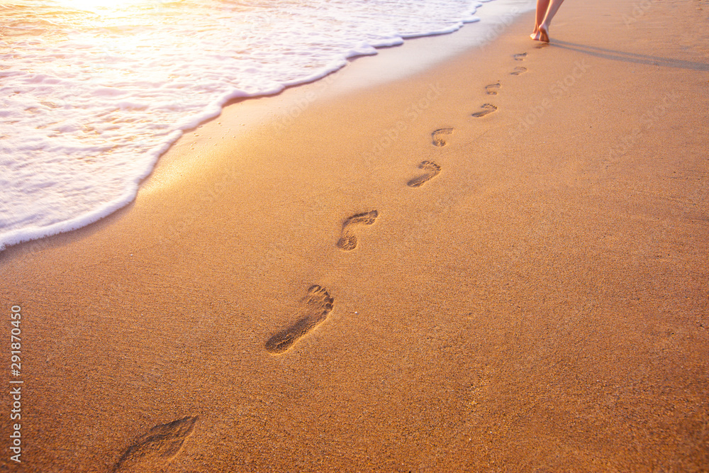 Fototapety, obrazy: beach, wave and footprints at sunset time