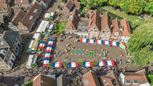 Aerial Drone View Of Traditional Cheese Market In Edam From Above, Architecture And Cheese Market Square In Typical Dutch Town, Holland, Netherlands