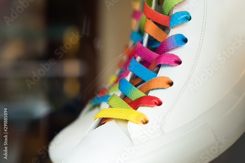 Closeup of a sneaker with colored shoelaces Poster Mural XXL