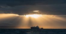 Oil Tanker Ship In The Ocean. Sunset Sky. Early In The Morning, The Sunrise. South Africa. Mossel Bay