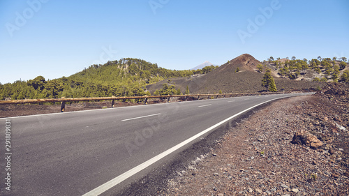 Pays d Asie Scenic road with Teide Volcano in distance, color toning applied, Tenerife, Spain.