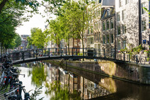 Old Gabled Buildings Reflecting In A Canal, Amsterdam, North Holland, The Netherlands