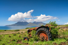 An Abandoned Tractor On A Clea...