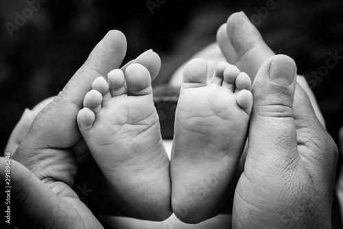 Baby feet in mothers hands.