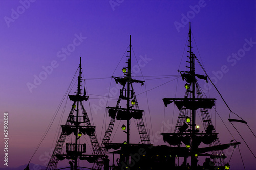 Fototapeta romantic vacation cruise ship wooden medieval mast dark silhouette and gas lamps