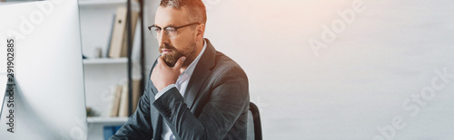 Fototapety, obrazy: panoramic shot of handsome businessman in formal wear and glasses looking at computer