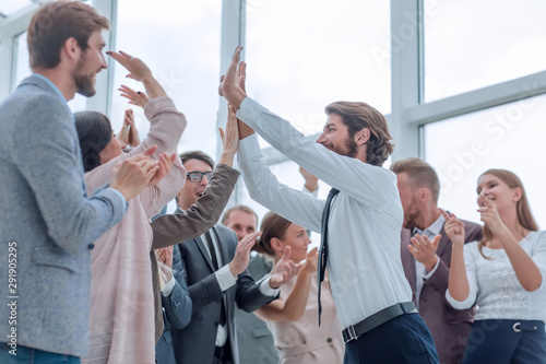 Fototapety, obrazy: corporate group of employees congratulating each other on the victory