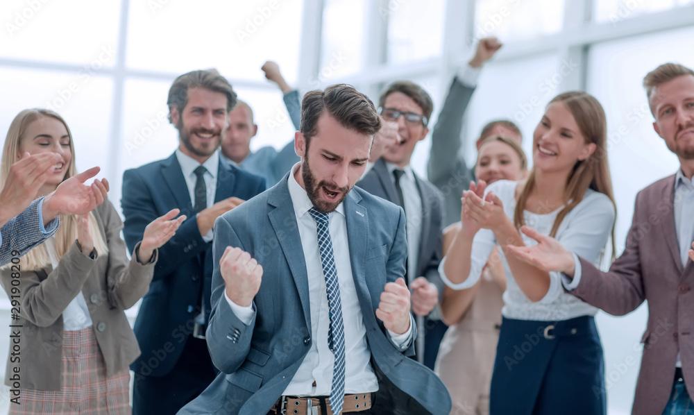 Fototapeta close up. business team applauding their jubilant leader