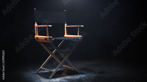 Director Chair, Movie Clapper and Megaphone in the volumetric light on a black background Wallpaper Mural