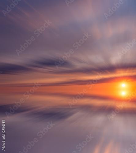 Beautiful illuminated sky at sunset, multi-colored clouds and bright sun over a calm sea Canvas-taulu