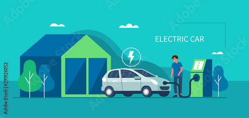 Foto  Man character standing near electric recharge station and charging an electric car battery