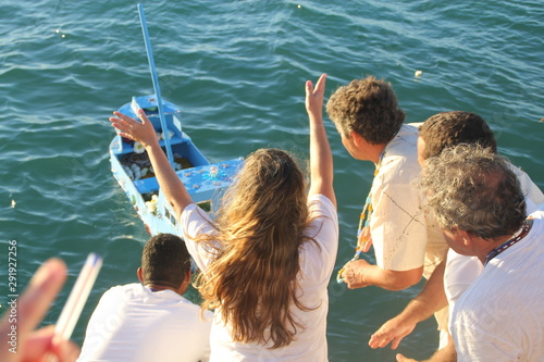 Fotografie, Tablou  Religious group sends offerings to Iemanja, queen of the sea