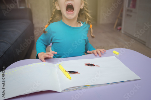 The cute little girl looking and afraid of cockroaches, Because the cockroaches Canvas Print