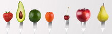 Collage Of Separately Fruits And Vegetables On Forks On Grey