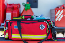 First Aid Kit An Open  Red First Aid Kit Bag With A Black Zip And Handle