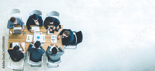 Fotografía  Top view on a group of businessman and businesswoman having a meeting and making a business commitment
