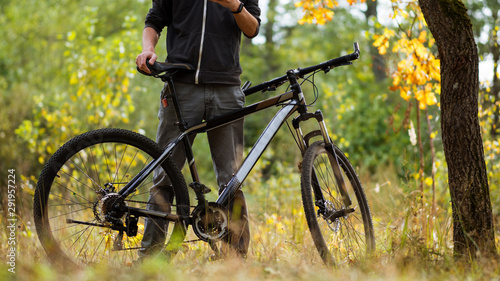 Garden Poster Bicycle Guy cyclist in autumn forest in October. Active lifestyle. Outdoor activities and Cycling