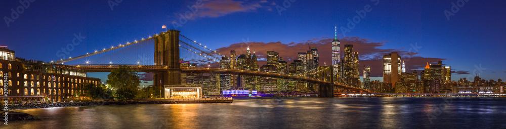 New York City skyline buildings Brooklyn Bridge evening sunset