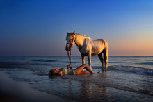 Woman On Beach With Horse