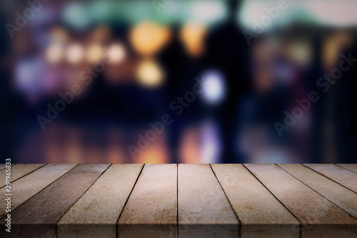 Wood table on blurred  cafe, coffee shop, bar, background. Canvas Print