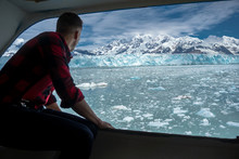 Young Is Looking On A Beautiful Hubbard Glacier. He Is On A Cruise Ship In Alaska. Gentleman Is Wearing A Lumberjack Shirt And Watching The Iceberg.