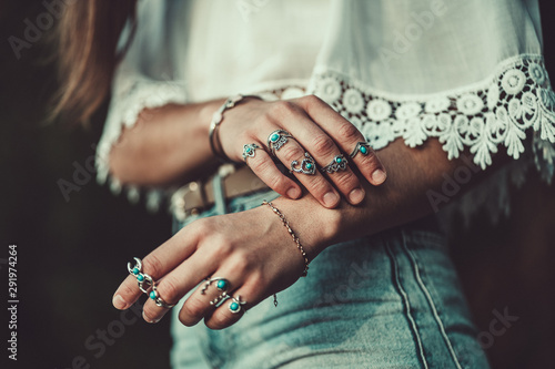 Fashionable boho chic woman in a white short blouse with silver turquoise jewelry фототапет