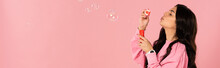 Funny Girl Blowing Soap Bubble...