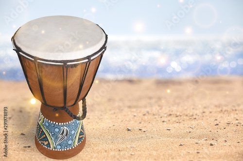 Photographie African drum isolated on white background